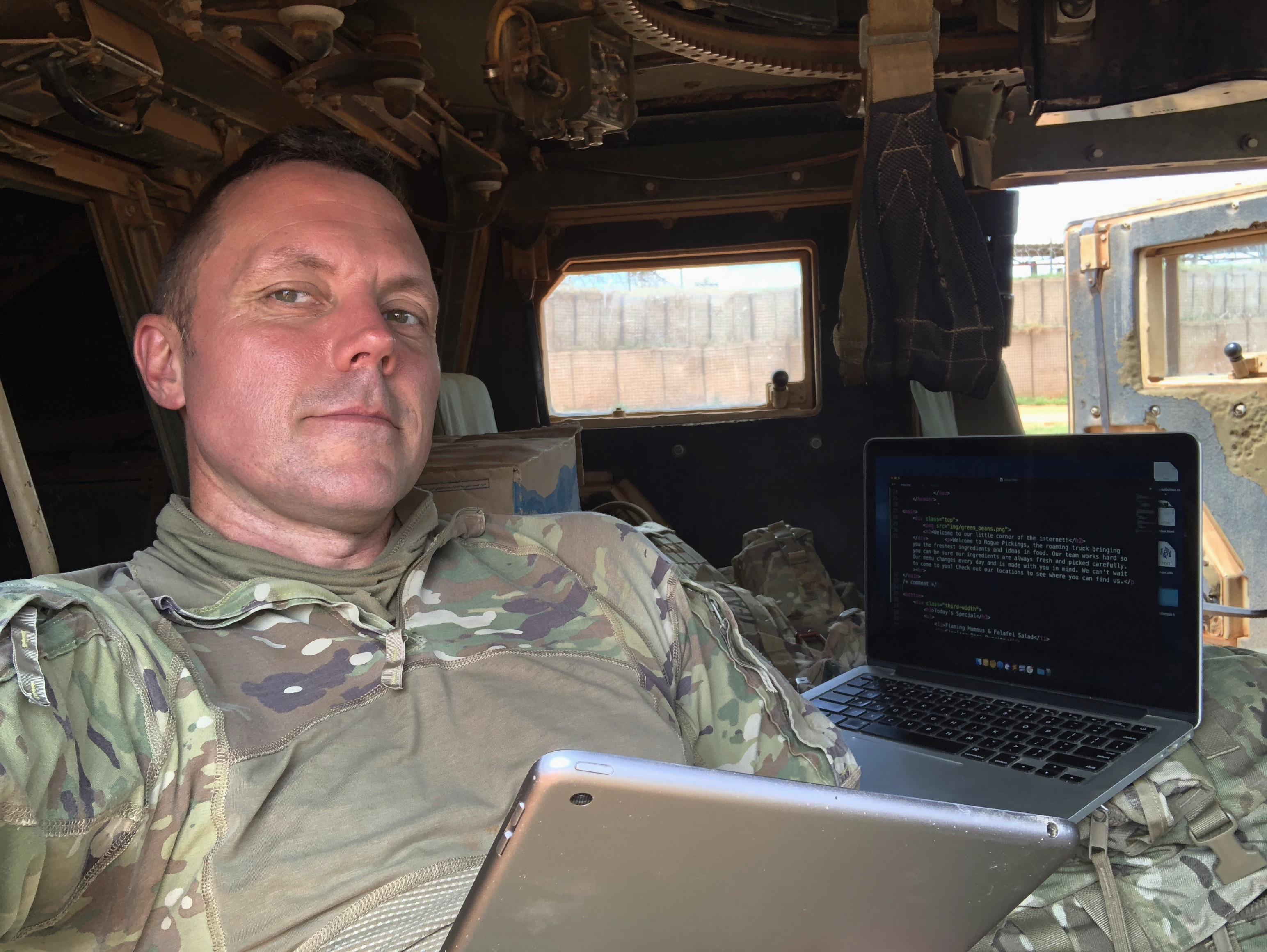 An iPad 2, a 2013 MacBook Pro, and no internet in the back of a humvee.no problem.
